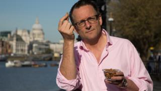Michael Mosley holds up almond against backdrop of River Thames and St Paul's Cathedral