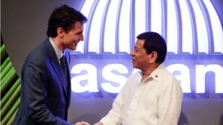 Canadian Prime Minister Justin Trudeau greets Philippines President Rodridgo Duterte