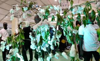 Visitors look at a display of cotton at the opening of the fourth International Exhibition of Agriculture and Animal Resources (SARA 2017) in Abidjan on November 17, 2017