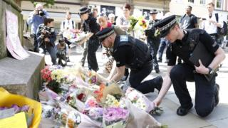 Police lay flowers after the Manchester Arena attack