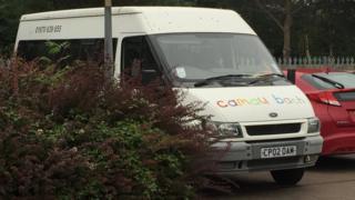 A minibus parked at Camau Bach