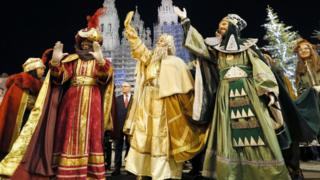 The Three Wise Men Mechor (C), Gaspar (R) and Baltasar (L) greet people during procession in Madrid on 5 January