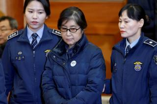 """Choi Soon-sil, the woman at the centre of the South Korean political scandal and long-time friend of President Park Geun-hye, arrives for a hearing arguments for South Korean President Park Geun-hye""""s impeachment trial at the Constitutional Court in Seoul, South Korea, 16 January 2017."""