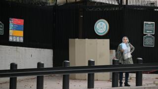 Woman waits at US embassy in Ankara