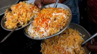 Plates of mutton biryani are served at an outside eatery in Lucknow on November 22, 2014.