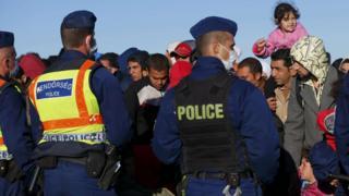 Roszke, Hungary - refugees face police, 7 Sep 15