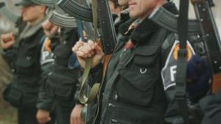 Members of the Kosovo Liberation Army hold their weapons in this 1999 picture