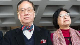 Former Hong Kong chief executive Donald Tsang (L) and his wife Selina (R) leave the High Court as the jury adjourns to deliberate a verdict in his high-profile corruption trial in Hong Kong on February 16, 2017.