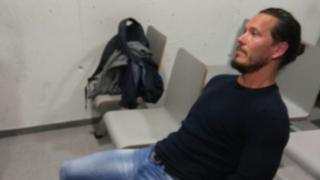 Jamie Acourt, while in police custody in Spain