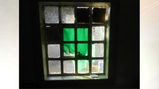 Window covered by cardboard