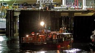 Douglas lifeboat Sir William Hillary berthing the casualty vessel at the Battery Pier