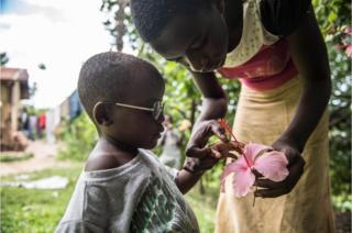 Criscent's cousin shows him a flower