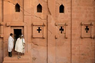 """Ethiopian Orthodox pilgrims leave after attending a morning prayer session at the Bete Amanuel, """"House of Emmanuel"""" monolithic orthodox church, ahead of Ethiopian Christmas in Lalibela, Ethiopia January 6, 2018."""