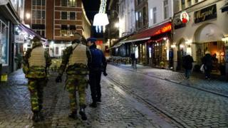 Police patrol near the Grand Place in the centre of Brussels
