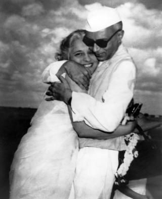 Mr Nehru and his sister Vijayalaxmi Pandit hug at the Delhi airport