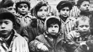Освобожденные дети - узники лагеря смерти Освенцим