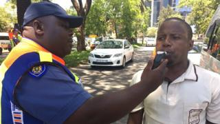 A road block operation in Rosebank, Johannesburg where a passenger is being checked for alcohol levels