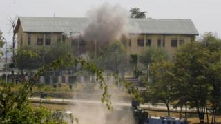 Smoke and dust rises from an Indian Border Security Force (BSF) building, that was held by suspected militants, after it was hit by explosives fired by government forces in Srinagar on October 3, 2017.
