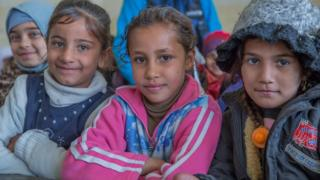 (From left) Heba, Noor, and Janna are back in class at a recently re-opened school in eastern Mosul (23 January 2017)