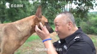 Police dog handler Bai Yan with Little Dragon, one of the retirement home residents