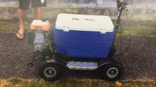 A ride-on cooler