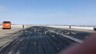 Precious metal bars scattered across the runway at Yakutsk airport on 15 March