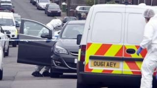 Police at the scene in Luton