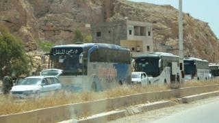 إجلاء بعض مسلحي المعارضة من حي البرزة في العاصمة دمشق