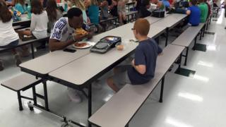 Travis Rudolph, the wide receiver for Florida State, eating lunch with Bo Paske