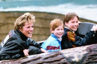 Diana, Princess of Wales, with sons Prince William and Prince Harry during a visit to Thorpe Park amusement park in 1993