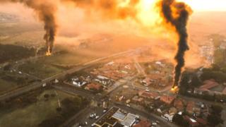 Burning vehicles filmed from the air