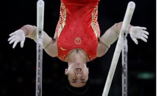 China's You Hao performs on the parallel bars during the artistic gymnastics men's apparatus final at the 2016 Summer Olympics in Rio de Janeiro, Brazil, 16 August 2016