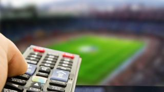 Football and TV remote