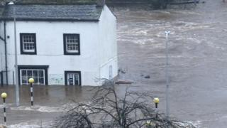 Flood waters rise to window level in Cockermouth, in December 2015