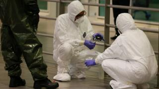 3 A Hazmat (hazardous materials) team conducts checks inside Kuala Lumpur Internatinal Airport 2 (KLIA2) airport terminal at Sepang, Malaysia, 26 February 20