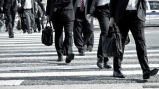 Commuters cross the road in Tokyo, Japan