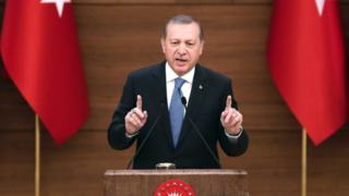 """Turkey""""s President Recep Tayyip Erdogan delivers a speech during the mukhtars meeting at the Presidential Complex in Ankara on April 19, 2016."""