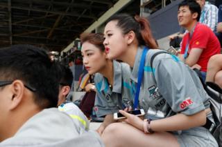Spectators look on