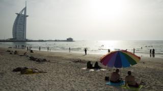 Beachgoers in Dubai