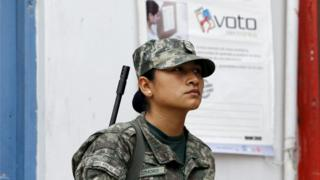 """Peruvian soldier patrol a polling station after workers of Peru""""s National Office of Electoral Processes (ONPE) leave voting materials, in Surco"""