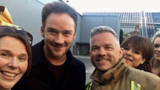 Russell Watson with firefighter outside the SEC