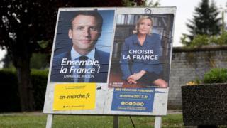 Cartazes das campanhas de Emmanuel Macron e Marine Le Pen