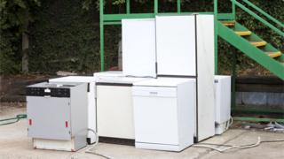 Discarded white goods at recycling centre