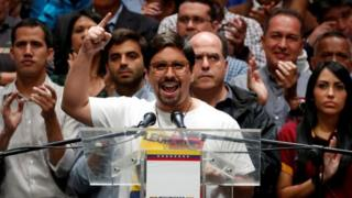 Freddy Guevara (C), first Vice President of the National Assembly and lawmaker of the Venezuelan coalition of opposition parties (MUD), talks to the media during a news conference in Caracas, Venezuela July 17, 2017.
