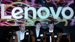 Lenovo's CEO Yang Yuanqing (C) and President Gianfranco Lanci (L) pose before a press conference in Hong Kong