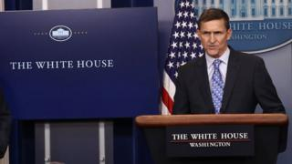 White House Press Secretary Sean Spicer (L) yields the briefing room podium to National Security Adviser Michael Flynn February 1, 2017 in Washington, DC.