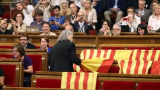Flags draped over benches before the vote of a referendum law on independence at Catalonia's regional parliament in Barcelona, 6 September 2017