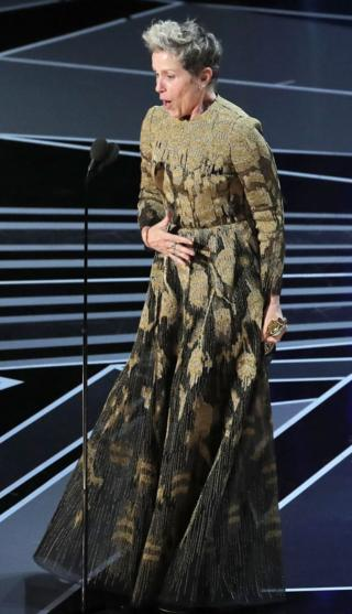 Frances McDormand onstage with her Oscar