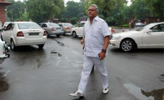 "This file photograph taken on August 7, 2013 shows Vijay Mallya, Member of Parliament and then Chairman of the United Breweries Group, as he arrives at Parliament House in New Delhi. India""s foreign ministry said April 28, 2016"