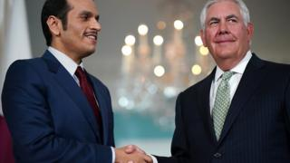 Qatari Foreign Minister Sheikh Mohammed Bin Abdul Rahman Al Thani shakes hands with US Secretary of State Rex Tillerson at the state department in Washington on 27 June 2017